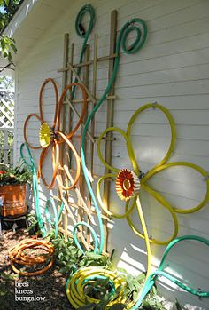 Hanging on the outside of the shed is this flower design art thingie - made out of colored hoses.  The middles are bundt pants.  Hello. Fun.