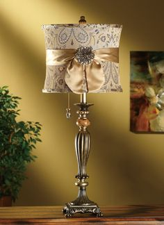 Soft and pretty-feminine and classy.  If you would like the details on this lamp  please email me at: rvmemphis@gmail.com