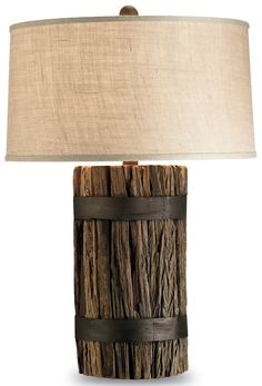 Urban rustic, farm chic, rough luxe-- whatever you want to call it, this lamp is all about using re-purposed materials and showcasing craftsmanship. Natural wood is bundled with wrought iron and toppe