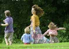 Maternal Princess Mary dotes on her brood at summer photo call