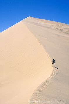 Hiker on Kelso Dunes, Mojave National Preserve California USA // Martin Beebee
