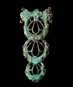 Tall Fancy Filigree Drop. F29 This lovely filigreed drop makes for a delicate necklace. It measures 48mm by 22mm. The product shown has the verdigris finish that I apply myself. You may also choose to order it in Oxidized Brass from the drop down menu.