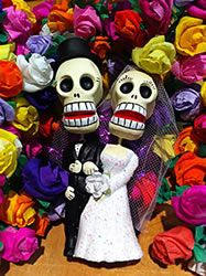 Skelton Wedding Couple surrounded by colorful small paper roses