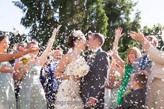 Summer wedding confetti photographed by Hampshire wedding photographers Jacqui Marie Photography. VISIT http://jacqui-marie-photography.co.uk for details.