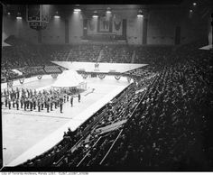 Maple Leaf Gardens was the site of many wartime rallies in support of Victory Bonds. These were variety shows that featured mock military exercises, bands and celebrities. One bond rally at the Gardens featured the Dionne quintuplets, another the U.S. radio stars Fibber McGee and Molly. Toronto, Garden Features, Rally, Wwii, Victorious, Exercises, Bond, The Outsiders, Gardens
