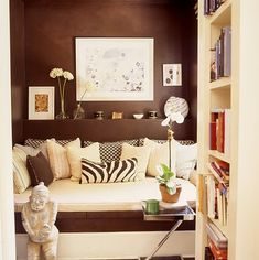 Lulu DK's UES apt , daybed, home office, brown paint on walls, zebra pillow