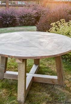 How to build a DIY salvage wood beam round dining table. Plans by Jen Woodhouse