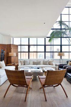 A stylish apartment living room overlooking Manhattan