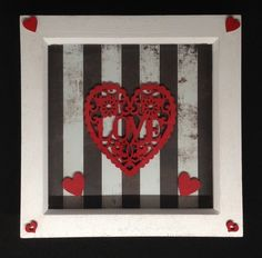 A wooden hand painted heart saying love on a black & white striped background. With hand painted wooden hearts in a box frame. Frames are white,wooden inches. Black And White Background, Striped Background, Wedding Day Gifts, Mothers Day Presents, Wooden Hand, Wooden Hearts, Box Frames, Gift Guide, Weaving