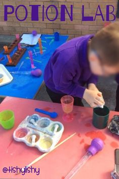 Potion Lab - test tubes, pipettes, syringes, coloured water and naturally found materials and a bit of recipe writing thrown in!!