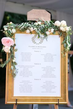 Display your seating chart at your wedding using a gold frame.