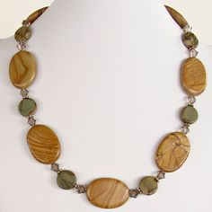 """This 22.5"""" gemstone bead necklace featuring oversized sand and gray colored jasper stones is tasteful and elegant. Buy it from our online shop today."""