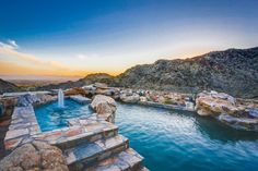 This pool located in Paradise Valley, AZ looks like a natural spring among the mountains.
