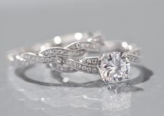 love the twisted bands. :) The diamond in this one is also really pretty. :)