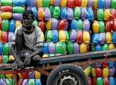 """fotojournalismus: """" A man rests on his cart after unloading plastic jugs near . fotojournalismus: """" A man rests on his cart after unloading plastic jugs near a shop at a main market in Colombo, Sri Pray For Sri Lanka, Sri Lanka Surf, Sri Lanka Photography, Fotojournalismus, Arugam Bay, Plastic Jugs, Chicago School, People Of The World, Photojournalism"""