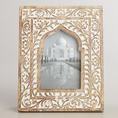 entry - at hinge and box for thermostat and keys: White Wooden Taj Arch Frame ($25 at World Market, very small)