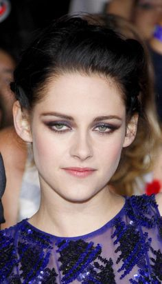 Kristen Stewart with makeup based on indigo shades, of at the LA premiere of Breaking Dawn Part.1