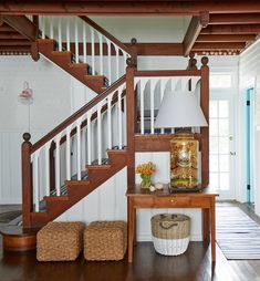 It doesn't get any cheerier than this Maine beach cottage designed by Leslie Rylee of Leslie Rylee Decorative Arts and Interiors! The New York City-based interior designer worked with builder Wright-R Maine Cottage, Beach Cottage Style, Coastal Cottage, Maine House, Beach House, Maine Beaches, White Staircase, Entry Stairs, Shingle Style Homes