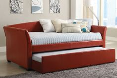 Daybed with pull out trundle. Perfect for a nursery. A place to rest in the wee hours with the baby, and great spot for guests to sleep.