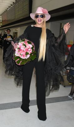 Lady Gaga (and her now infamous pink hat) arriving at  the Narita International Airport in Japan for the first time in two years to promote her latest album Joanne.  GETTY