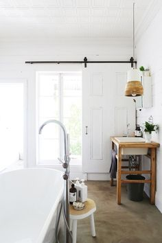 obsessed with the barn door and rustic sink pedestal!