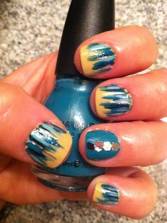 Nude background with waterfall design plus accent nail in teal with glitter pieces