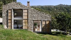 stone-abaton-architects-extremadura-house-12 Large wooden shutters that slide closed like a second skin, cover the large windows at night to trap in most of the home's daily solar heat gain.