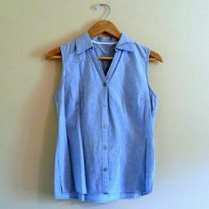 Chambray Button Up sleeveless blouse soft chambray feel. Pretty powdery blue. V-neck and small collar. Simple and stylish basic. Buttons up front. Tops Button Down Shirts