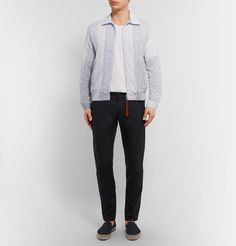 This Loewe piece combines the structure of a classic blouson jacket with the lightness of your favourite cotton shirt. Sporting slim white, blue and red stripes, it's designed with a neat spread collar, handy front pockets and a partially elasticated hem that creates subtle volume through the body. It works solo, but can also be layered over a tee.
