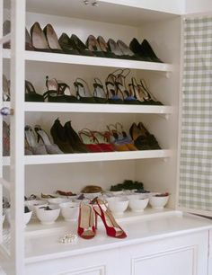 shoe cabinet love the jewelry in the white cups too