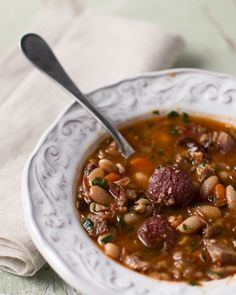 A Portuguese feijoada recipe, a rich and satisfying pork and beans stew. This is a Portuguese version of feijoada; the Brazilian version uses black beans. Portuguese Recipes, Portuguese Food, Spanish Recipes, Pork Recipes, Cooking Recipes, Learn Brazilian Portuguese, Pork N Beans, Bean Stew, Gastronomia
