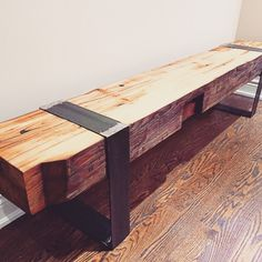 This reclaimed barn beam bench is made from a 150 year old 12 x 12 barn beam that has been milled in half, resulting in a 5.5 thick 12 wide bench top, finished in 100% all natural bees wax. Our steel legs are crafted in house using raw steel. Like all of our products we build heirloom quality products, designed to make a statement. Our barn beam benches are custom made to order.