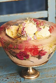 Love this idea! Frozen flower ice bowl with homemade icecream! Would look great as part of a Sundae bar (+ homemade waffle cones!) at a garden wedding. More floral ice-cube ideas here: http://www.thelane.com/the-guide/style-elements/food-styling/floral-ice-cubes