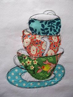 Dreaming About all the Tea in China/Raw edge applique and the handles are machine-quilted on in black thread.