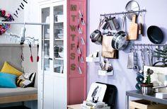 Eine Wand mit Edelstahlstangen, die mit Töpfen, Pfannen, Schneidebrettern und anderen Küchenutensilien bestückt sind.