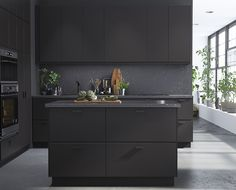 Ikea matte anthracite-coloured cupboard fronts made from 100% recycled materials.