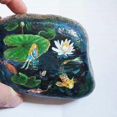Hand painted rock. Thumbelina. Koi fish pond. Water lily.  @tattiniko #paintedrocks #koifish