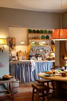intimate, skirted counter, pendant, cutting boards and utensils, lamp on counter  Belgian Pearls blog