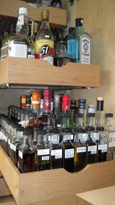Roll Out And Inserts For Bottle Storage In A Liquor
