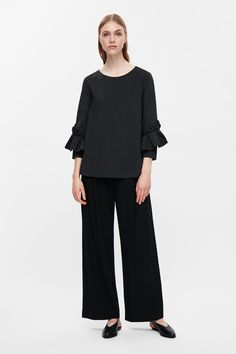 COS image 1 of Top with scuba frill sleeve in Black