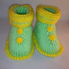 Green and Yellow booties with yellow pom poms