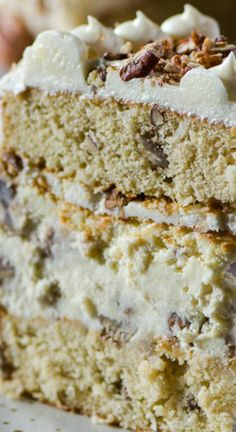 Italian Cream Cheesecake ~ Two layers of classic Italian Cream Cake and a complementary layer of coconut pecan cheesecake sandwiched in the middle make for one amazing dessert!
