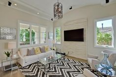 Living room: Love the light and wall-mounted TV
