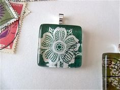 Necklace Pendants made from old stamps! So cool. Uses glass plates and dimensional magic.