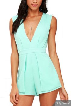 This mint green playsuit can make sure you're ready to turn heads this season. It is adorned with plunge v-neck, sleeveless and open back. Seamed and pleated bodice meets with a banded waist atop shorts with fluttering side panels. Pair it with your heels.