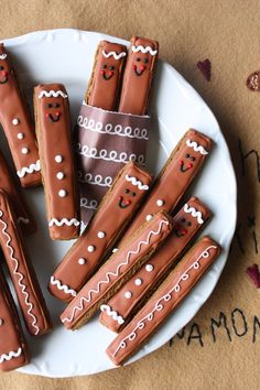 Gingerbread Men Cookie Sticks by Munchkin Munchies. For us lazy people, use kit kat bars or a twix!!!