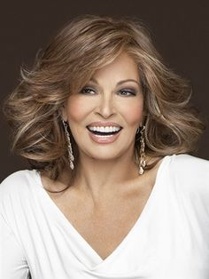 Goddess Wig by Raquel Welch: lace front for the option of off-the-face styling and a monofilament top for varied parting choices, this barely waved, layered, shoulder length silhouette can also be curled for a more dramatic effect.