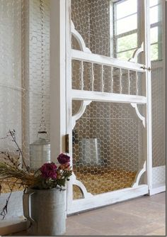 I'm trying to convince Buzz to include a great old screened door I bought last year in the new chicken coop we need. I like this idea.