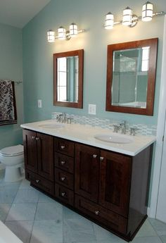 Benjamin Moore Catalina Blue with darker accents from vanity, mirrors and towels.