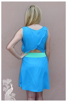 Ruffled Feathers Boutique - Raise The Curtain Dress, $39.99 (http://www.ruffledfeathersboutique.com/raise-the-curtain-dress/) Solid color yet unique due to the drapped and  scalloped cut out in the back. Add color with fun jewlrey or play it cool with an updo and a pair of long earrings.